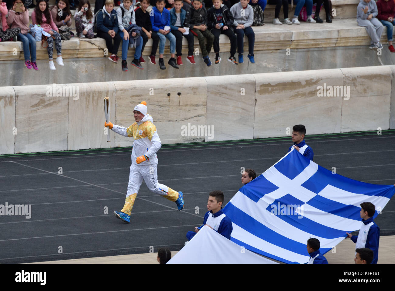 Athens, Greece, 31st October, 2017. The Greek skiing champion Ioannis Proios carries the Olympic Torch during the - Stock Image