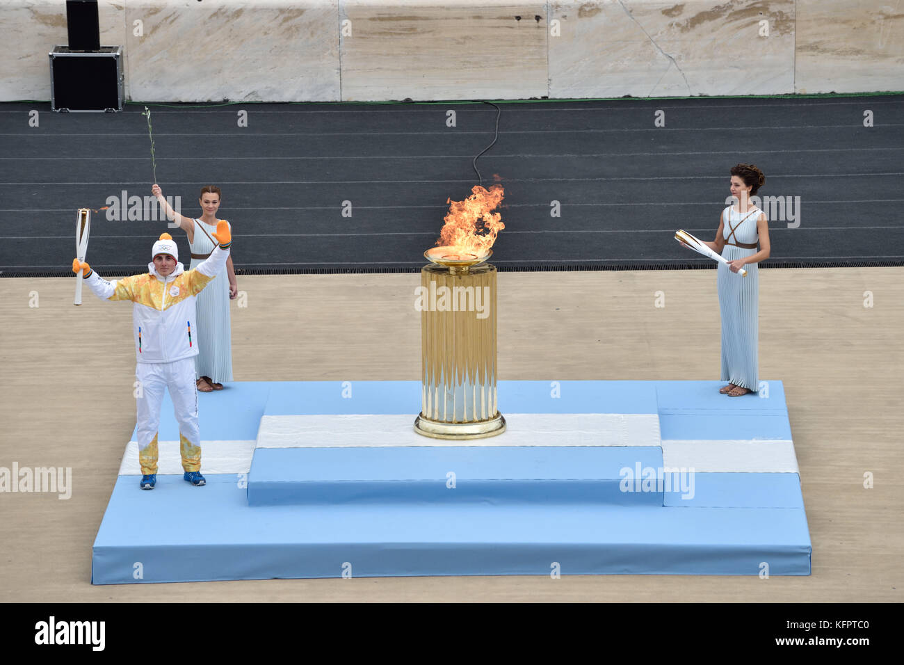 Athens, Greece, 31st October, 2017. The Greek skiing champion Ioannis Proios holds  the Olympic Torch in front of Stock Photo