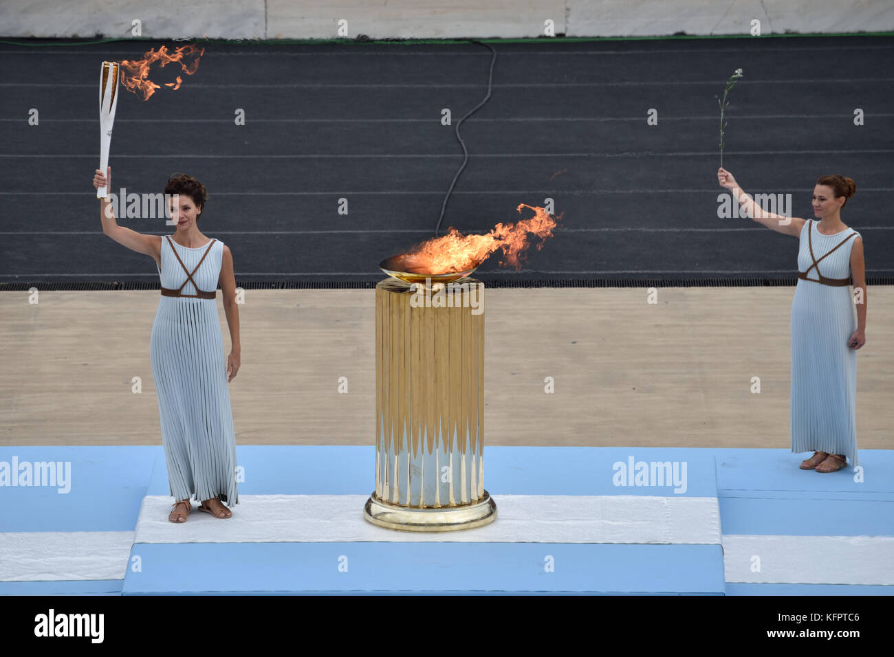 Athens, Greece, 31st October, 2017. High Priestess Katerina Lehou holds the OlympicTorch in front of the cauldron - Stock Image