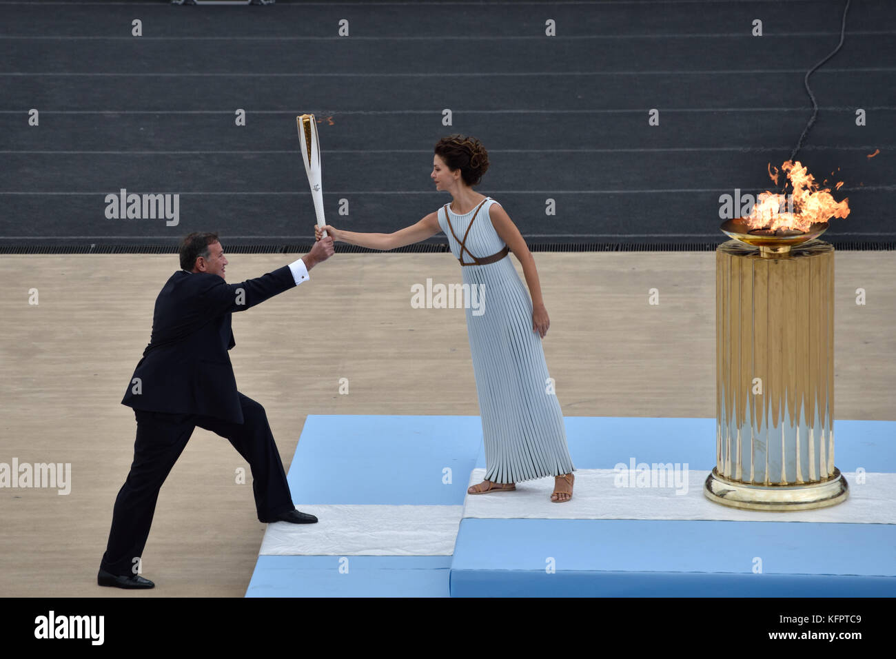 Athens, Greece, 31st October, 2017. High Priestess Katerina Lehou (R)  hands over  the Olympic Torch to the president - Stock Image
