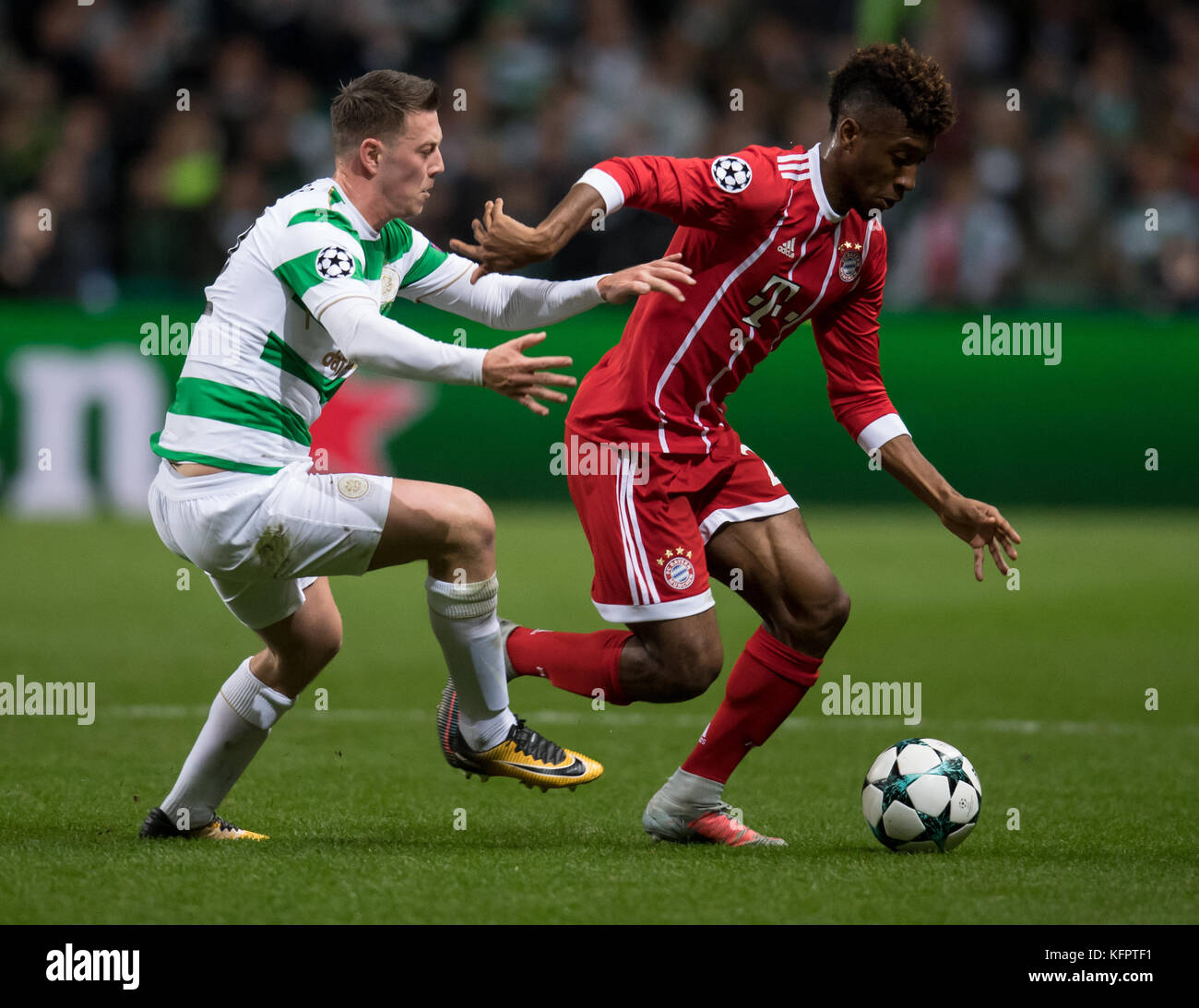 Glasgow, UK. 31st Oct, 2017. Kingsley Coman (r) of Bayern and Callum McGregor of Celtic vie for the ball during - Stock Image
