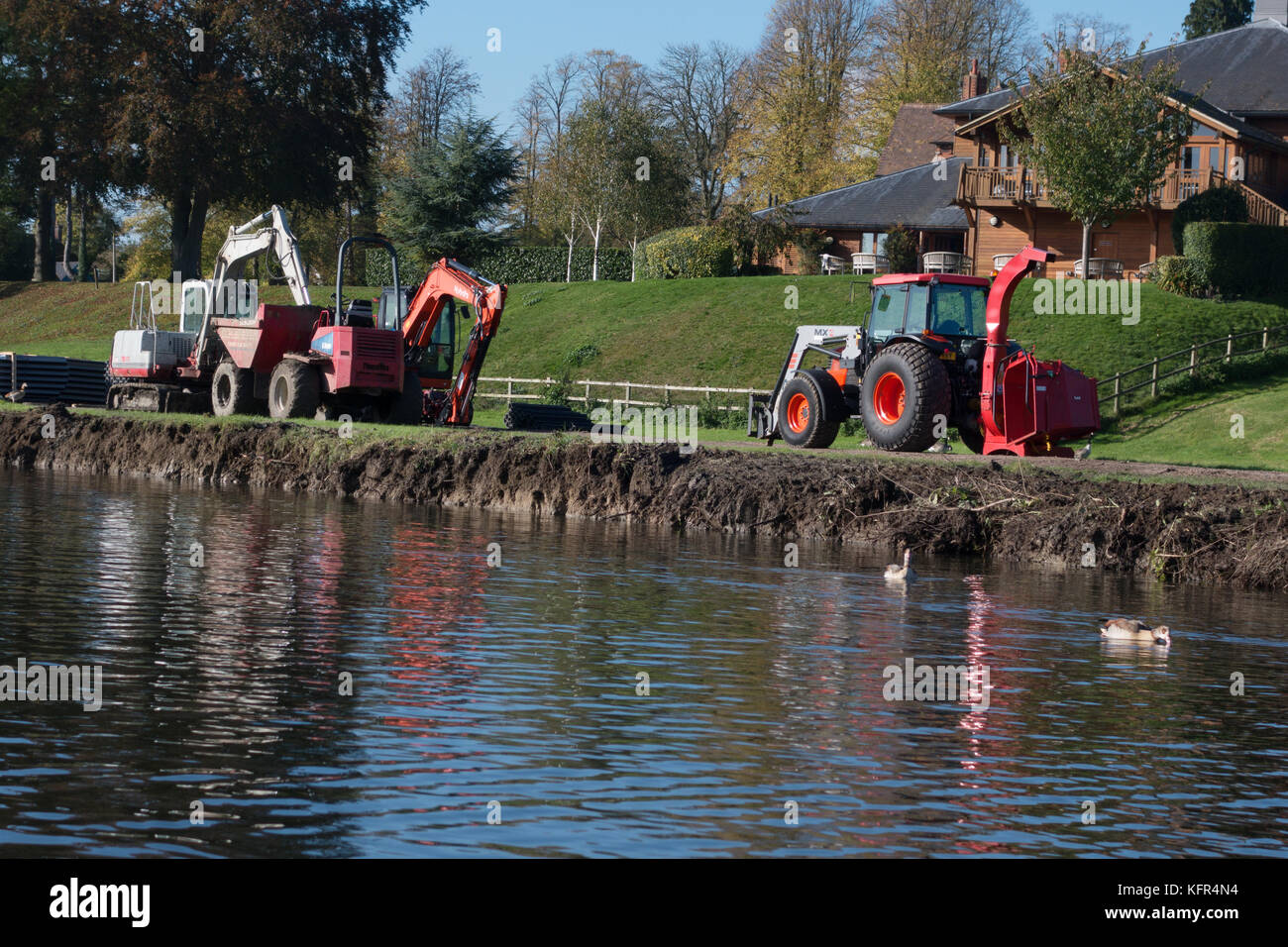 Building work on the Thames river bank, shoring up the bank at Moulsford, Oxfordshire UK - Stock Image