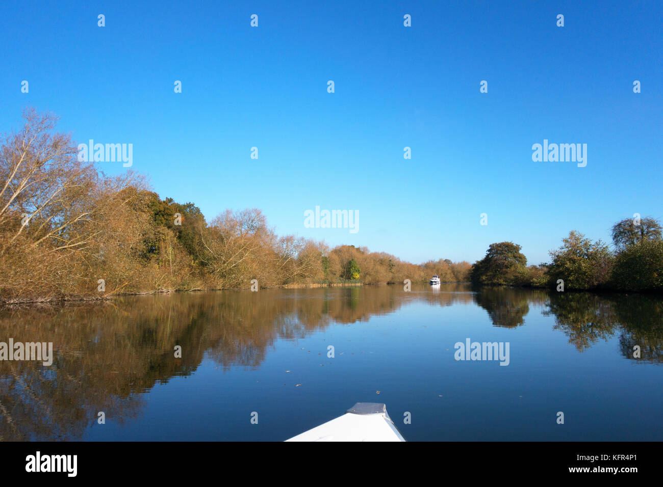 River Thames  Oxfordshire on a bright autumn day with blue sky and sunshine, Moulsford, Oxfordshire UK - Stock Image