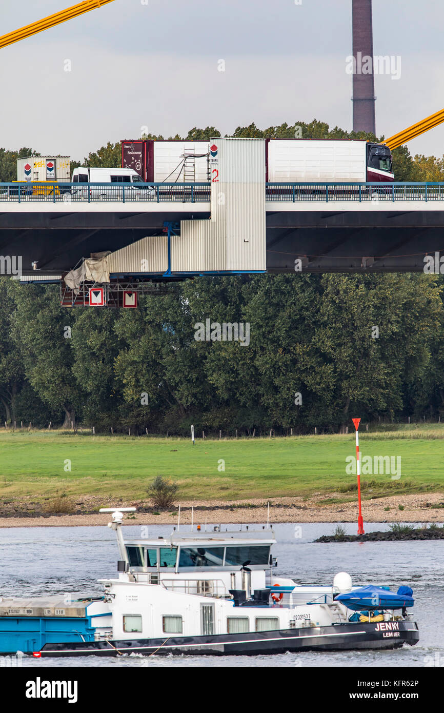 Rhine bridge of the motorway A40 near Duisburg, heavily damaged motorway bridge, with many cracks in the bridge - Stock Image