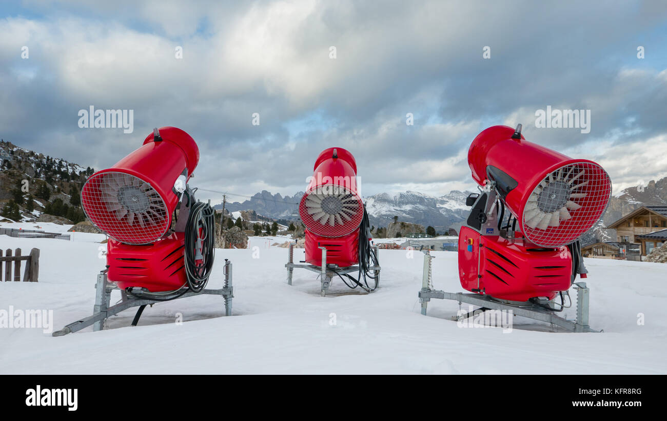 Rear view of three snow cannons in alpine ski resort - Stock Image