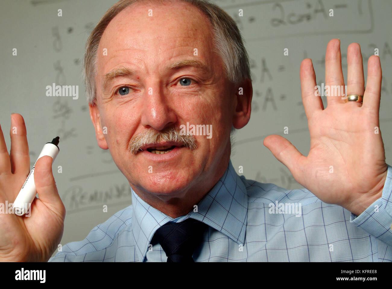 Teacher Eric Evans, Ysgol Dyffryn Taf School, Whitland, W.Wales, using a whiteboard for a class. Stock Photo