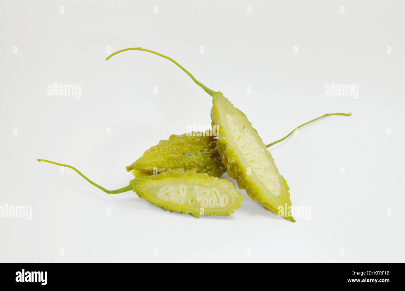 bitter cucumber slice on white background - Stock Image
