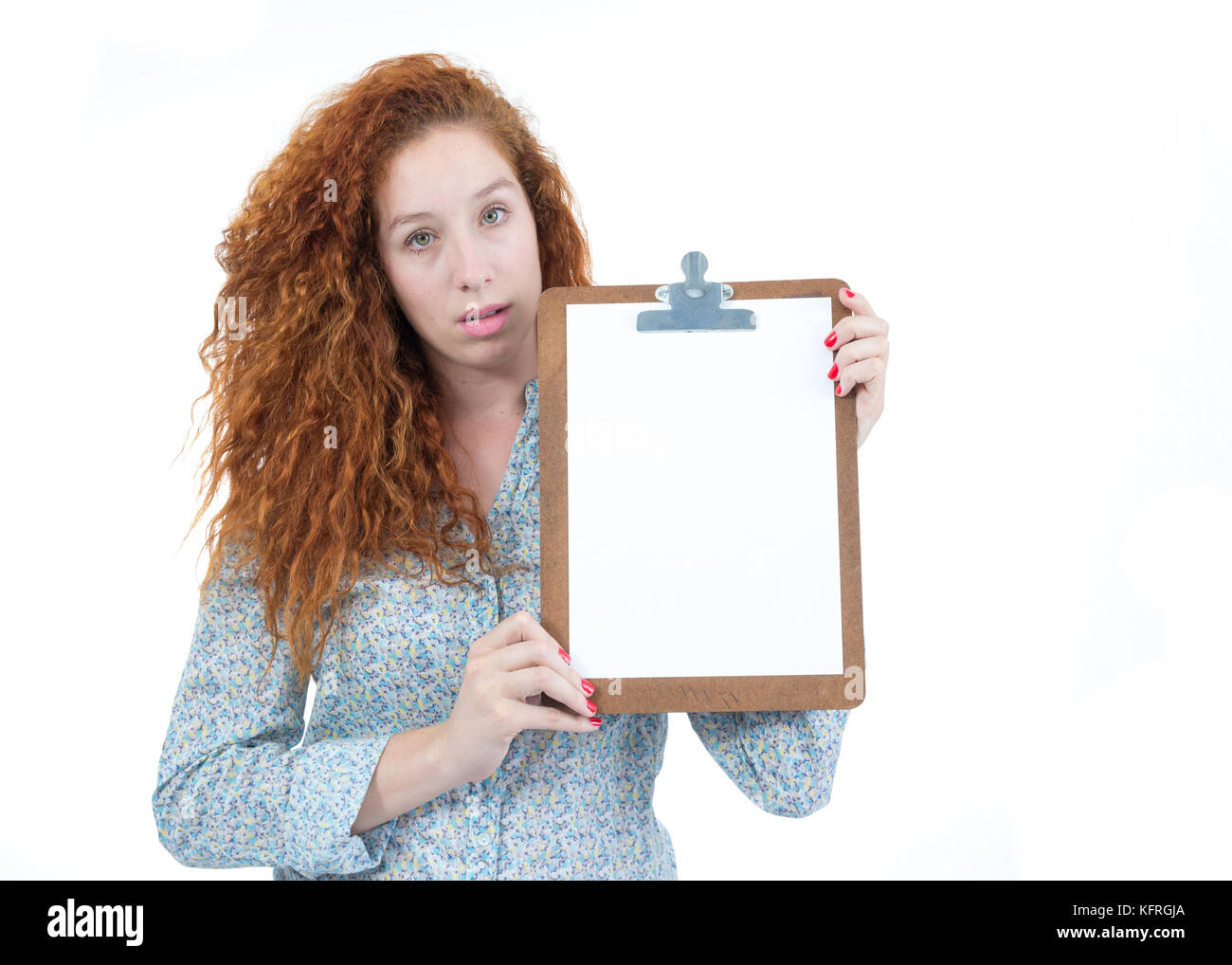 Beautiful woman is presenting a prancehta. Space for advertising content, information. Blank paper. A redheaded - Stock Image