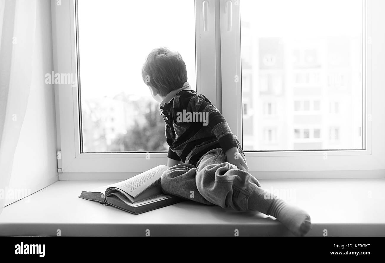 Boy Looking Out Window Black High Resolution Stock Photography And Images Alamy