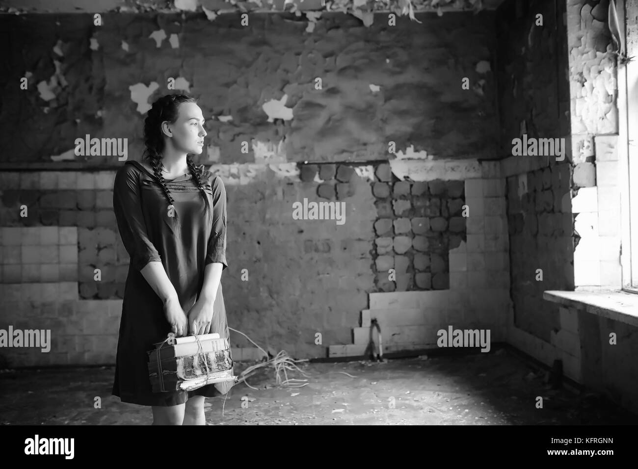 Retro girl in the old house reading books - Stock Image