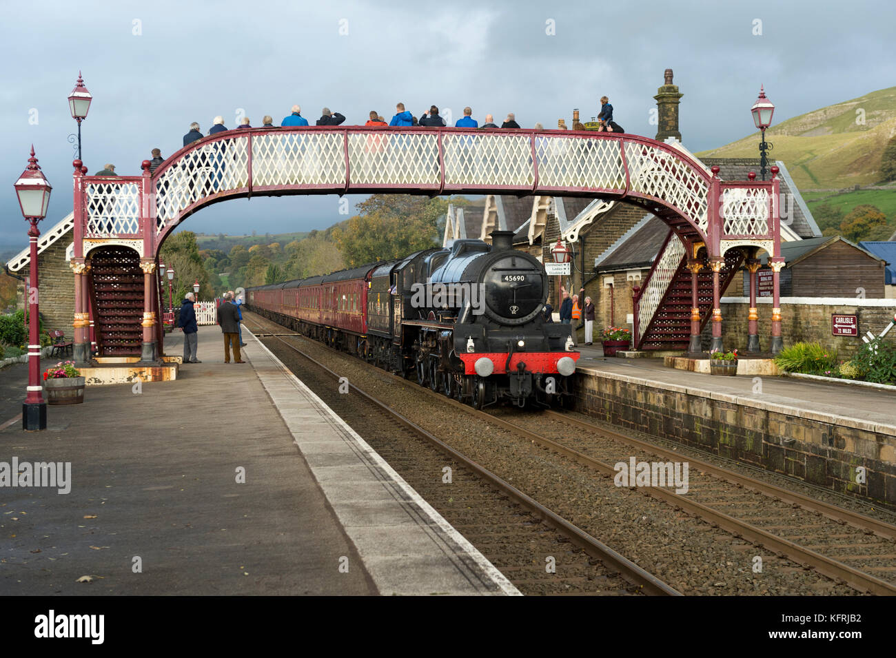 A steam special on the Settle-Carlisle railway line passes through Settle station, North Yorkshire, UK. The locomotive - Stock Image