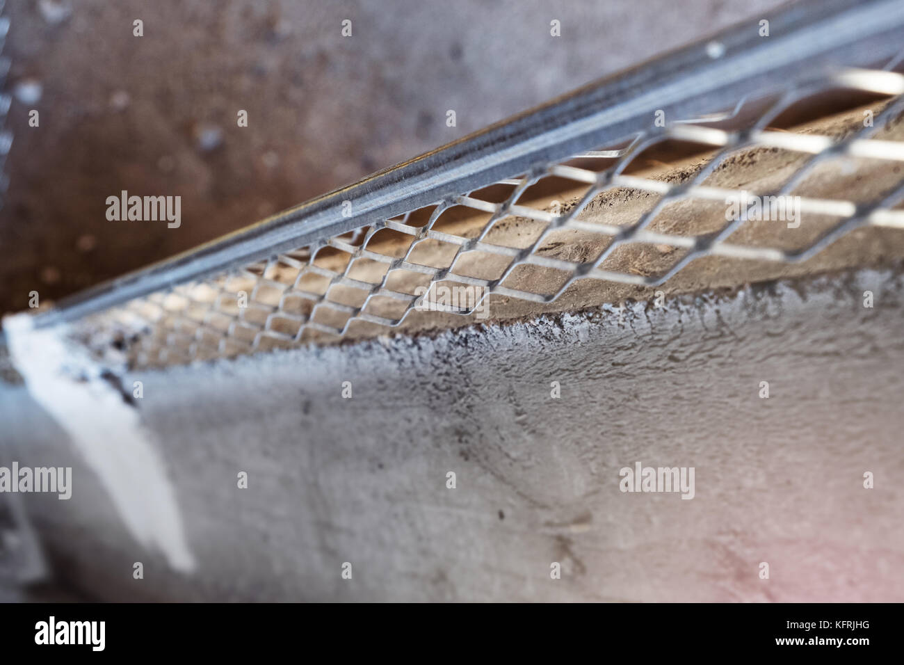 Plastering metal bead installed on the concrete wall corner - Stock Image