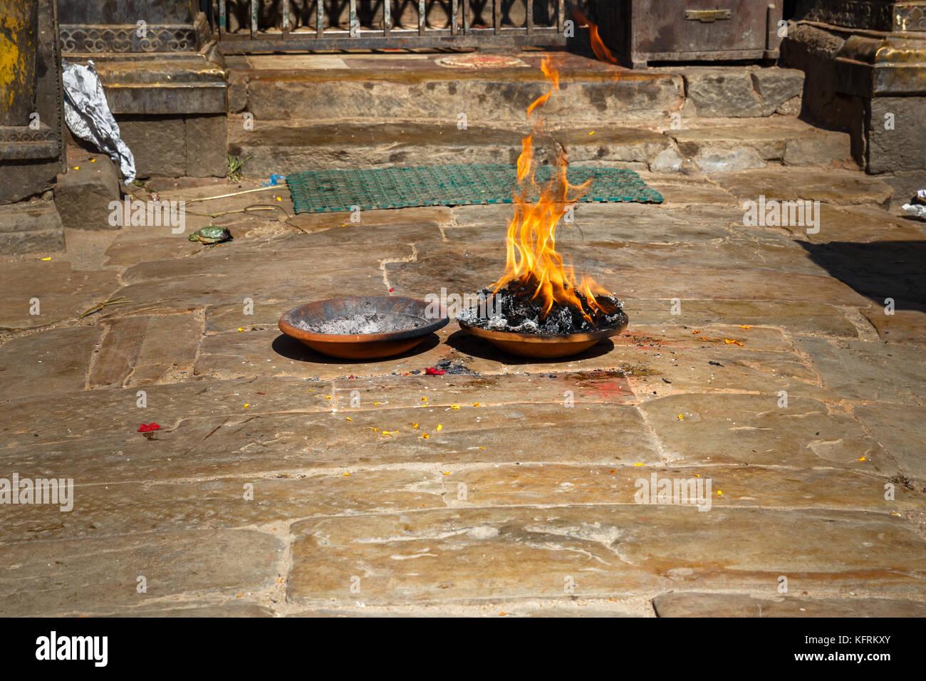 Ritual fire puja near the temple - Stock Image