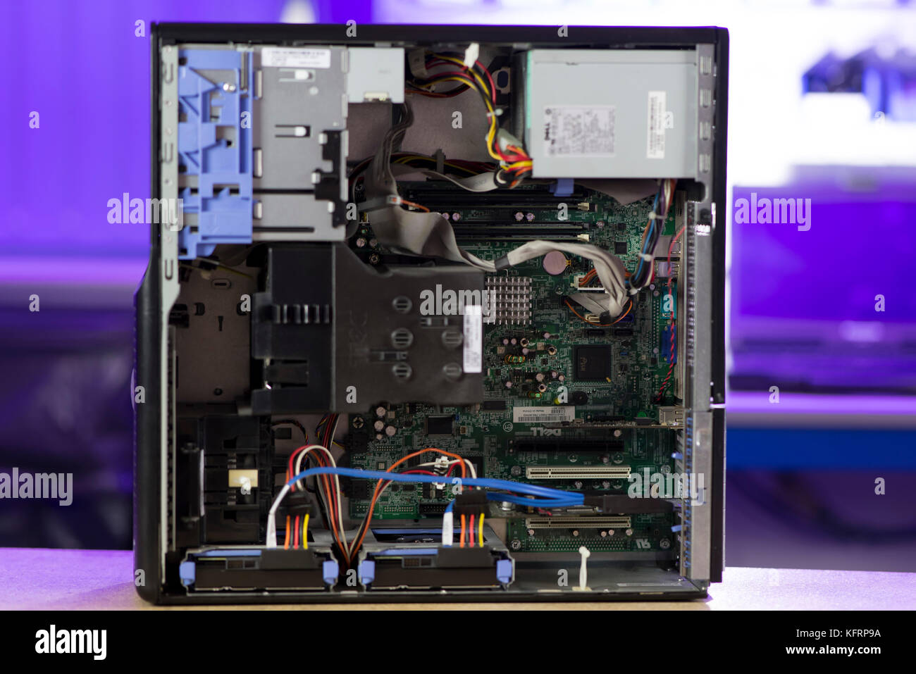 A PC personal computer tower showing the inside and internal areas including the motherboard, computer chips and - Stock Image