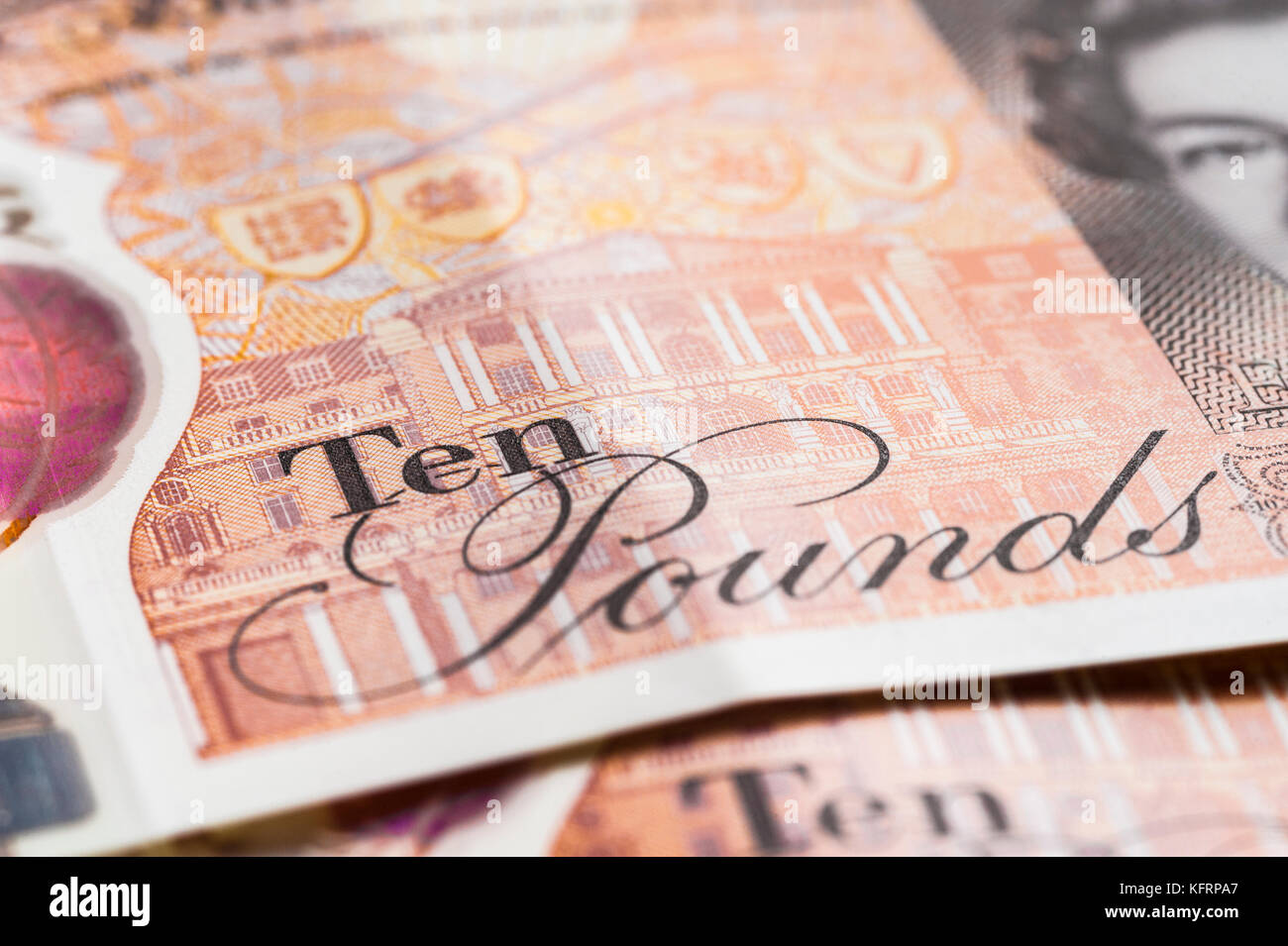 LONDON, ENGLAND – OCTOBER, 24: Closeup of the new British ten-pound note, featuring a portrait of Jane Austen. - Stock Image