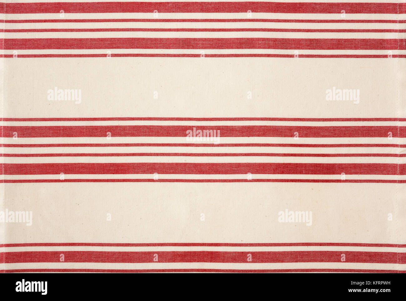 Traditional red and white striped cotton fabric kitchen bistro style tea towel tablecloth. Simple, classic, rustic Stock Photo