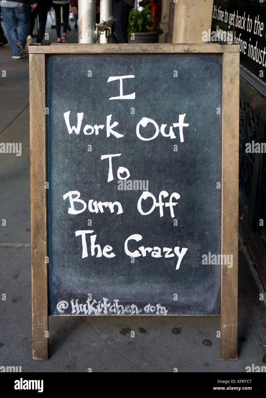 A funny sign about exercise and mental health outside the Hu Kitchen restaurant on Fifth Avenue in Greenwich Village, - Stock Image