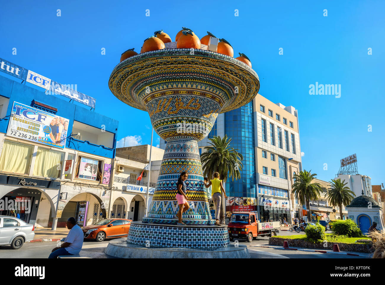 Cityscape with ceramic sculpture on road in city centre. Nabeul, Tunisia, North Africa Stock Photo