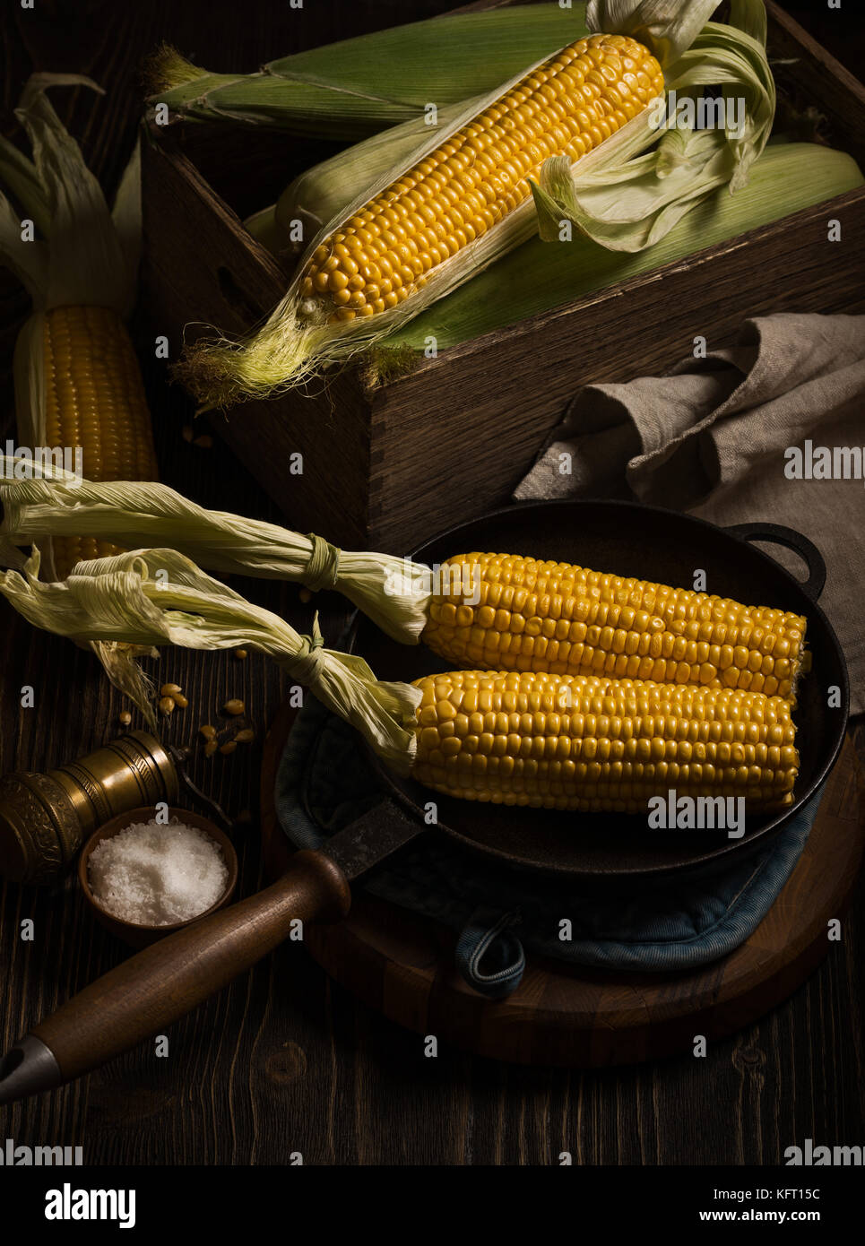 Corn cobs in the fry pan Stock Photo