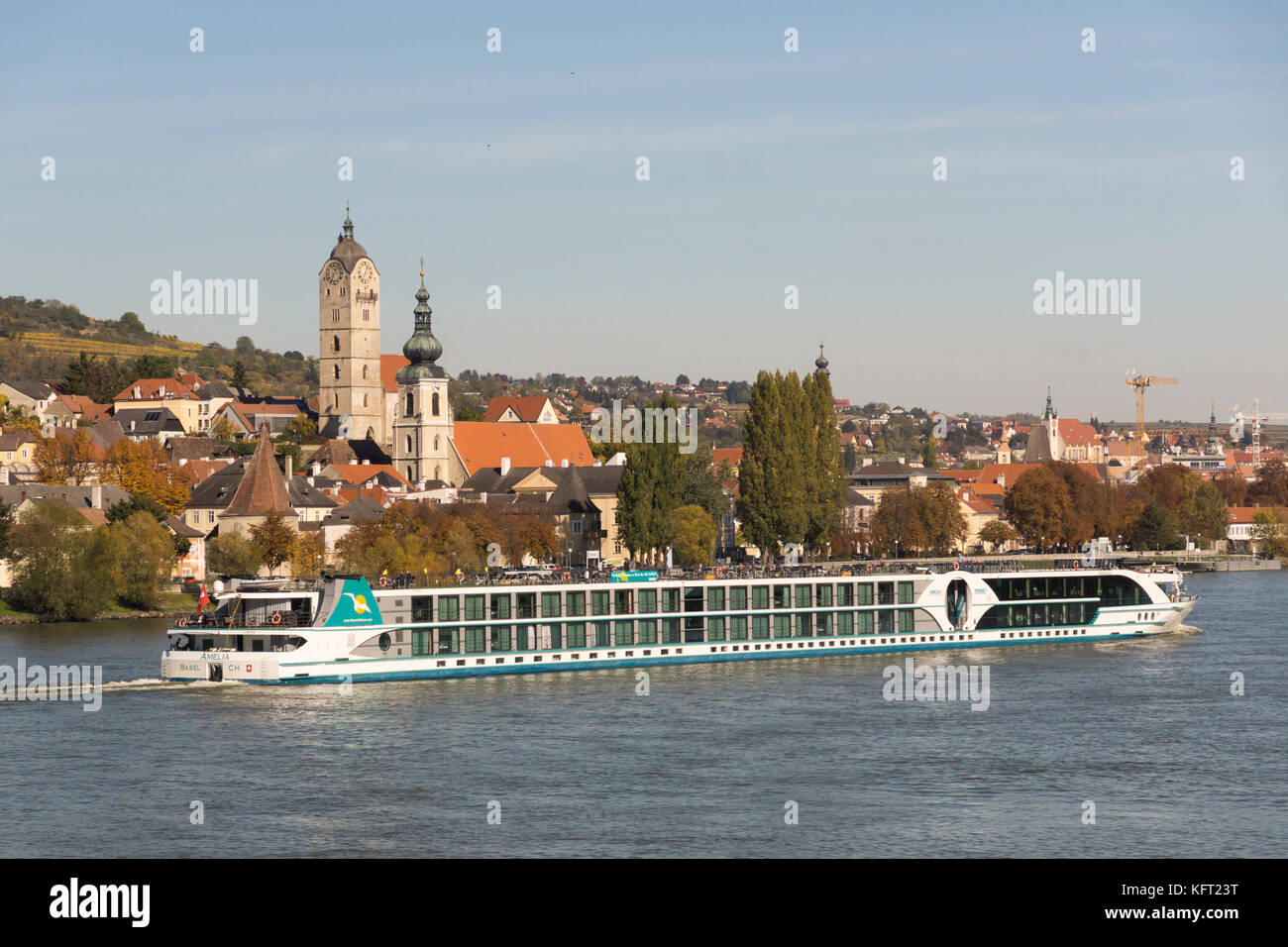 A tourist river cruiser on the river Danube passes in front of the historic centre of Stein an der Donau, UNESCO - Stock Image