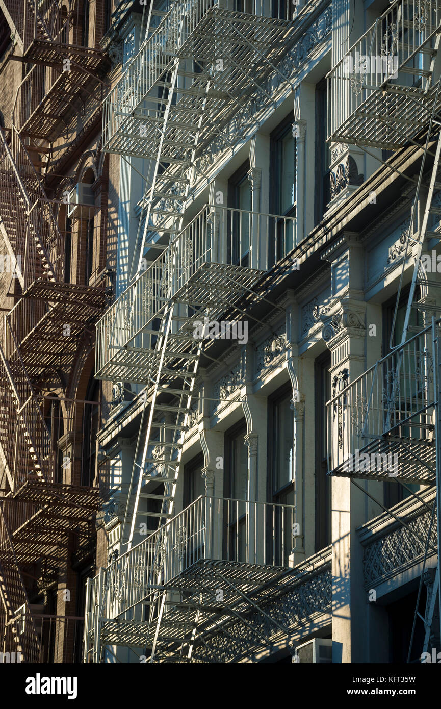 Architectural detail view of cast iron fire escapes in New York City - Stock Image