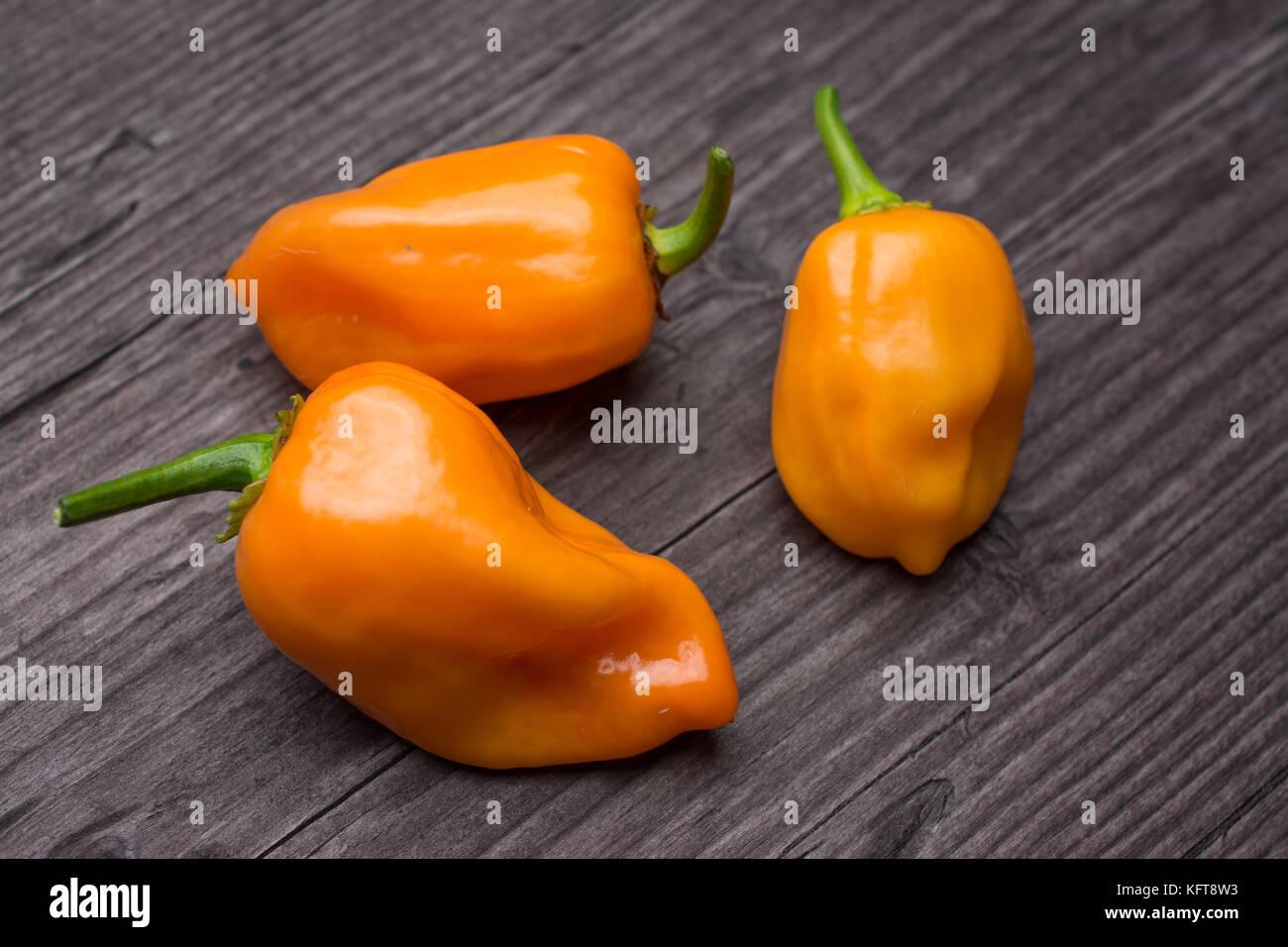 some vegetable of orange chili pepper habanero on wooden vintage background Stock Photo