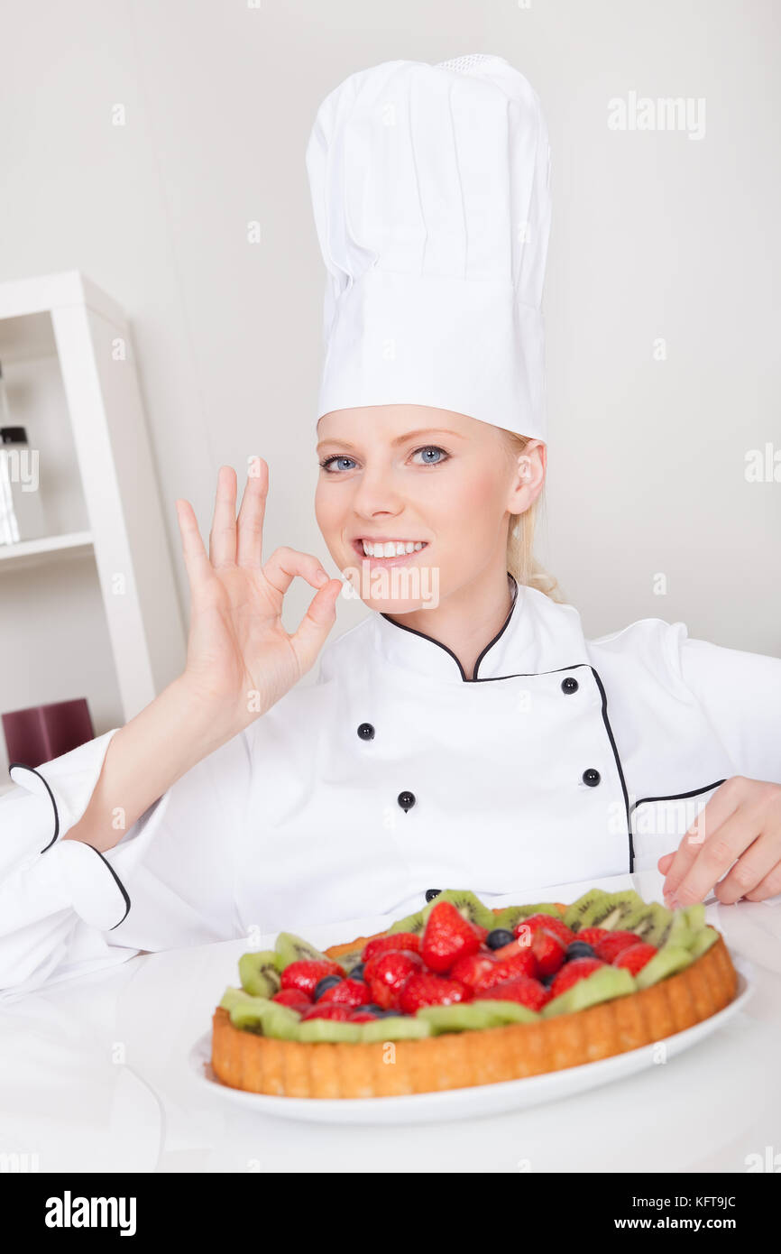 Beautiful chef woman making cake in the kitchen Stock Photo ...