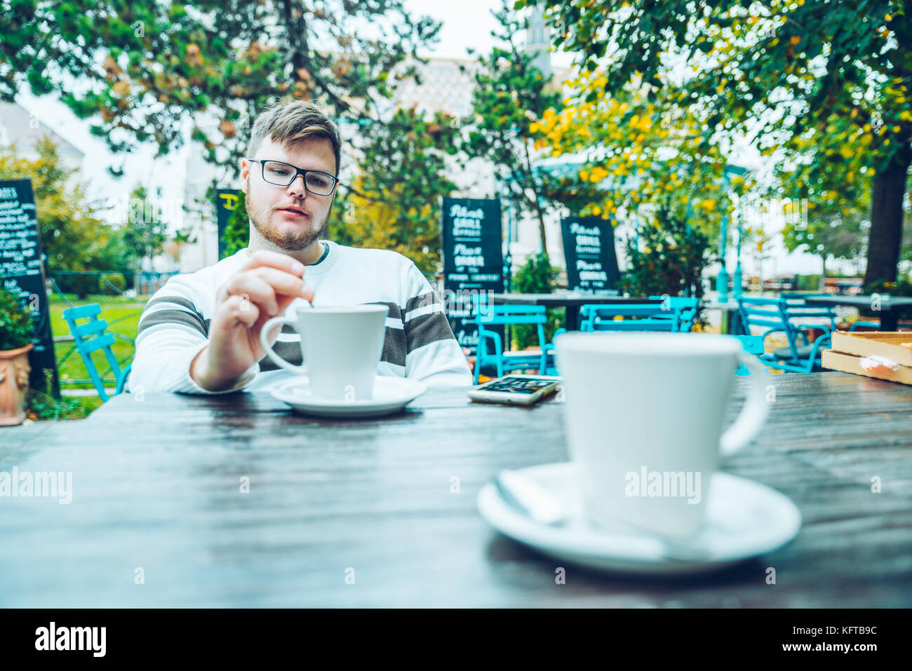 couple sitting in cafe outaside Stock Photo
