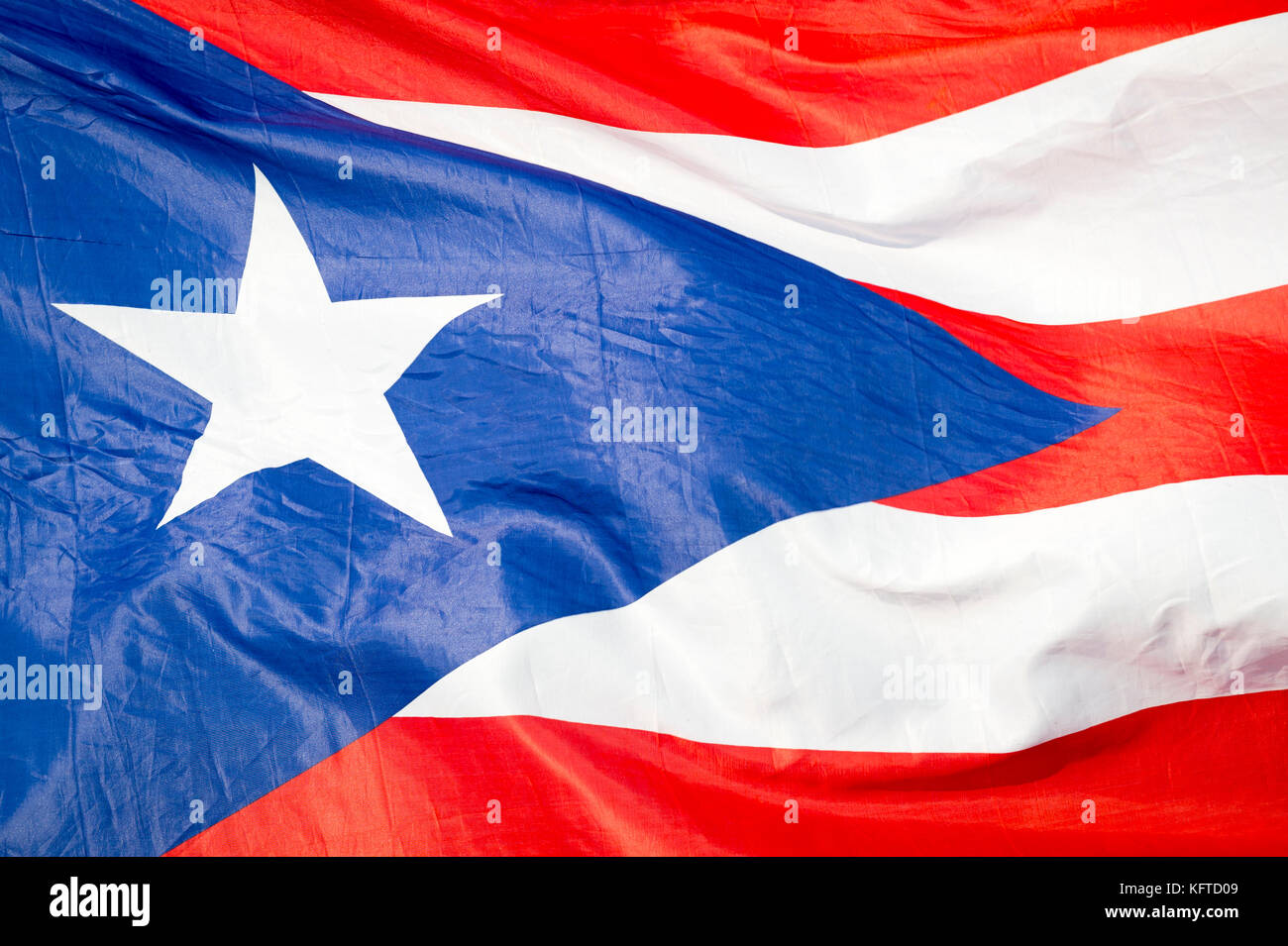 Abstract close-up view of flag of Puerto Rico fluttering in the breeze. - Stock Image