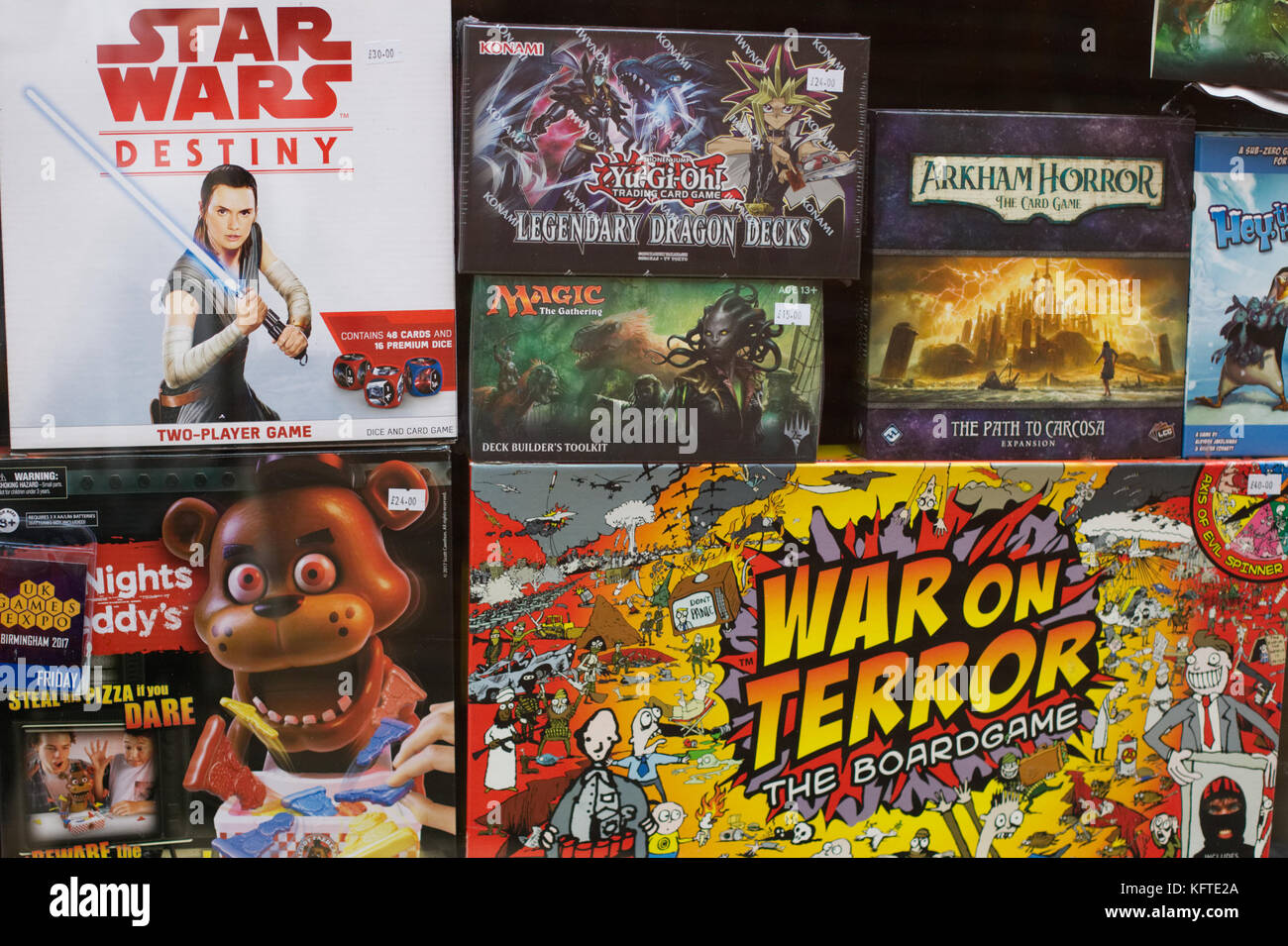 Assorted board games in store window - Stock Image