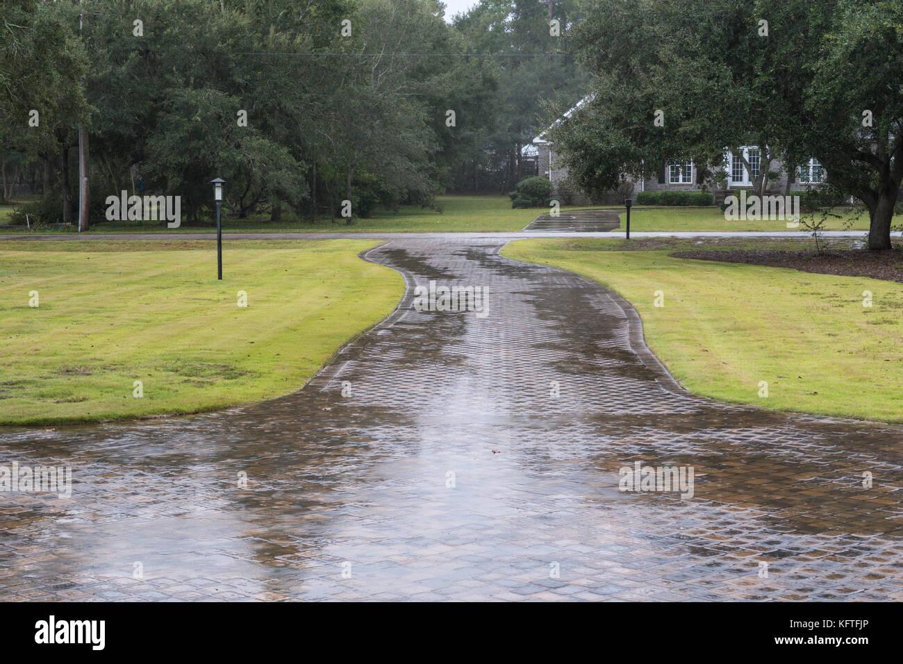 Wide Suburban Driveway in Rainstorm, SC, USA - Stock Image