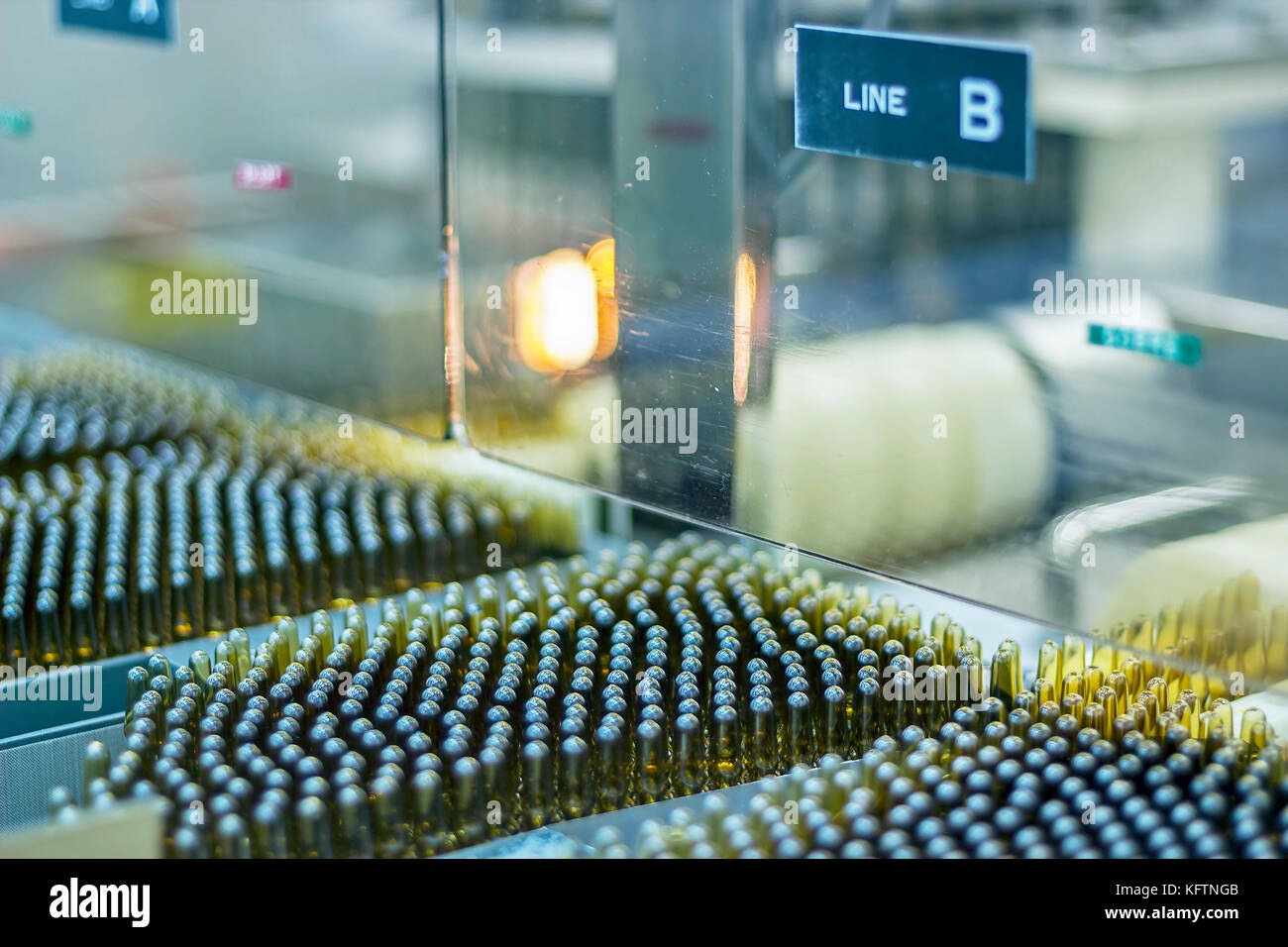Automatic inspection machine inspects vials and ampules for particulates in liquid and container defects. - Stock Image