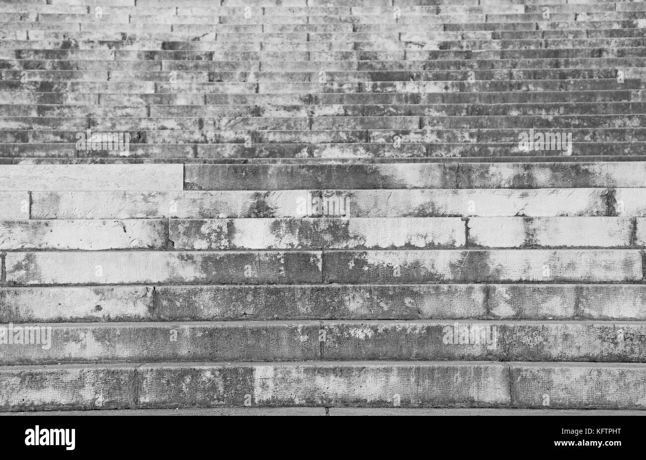 background of a gray stairway with the large steps towards the infinite - Stock Image