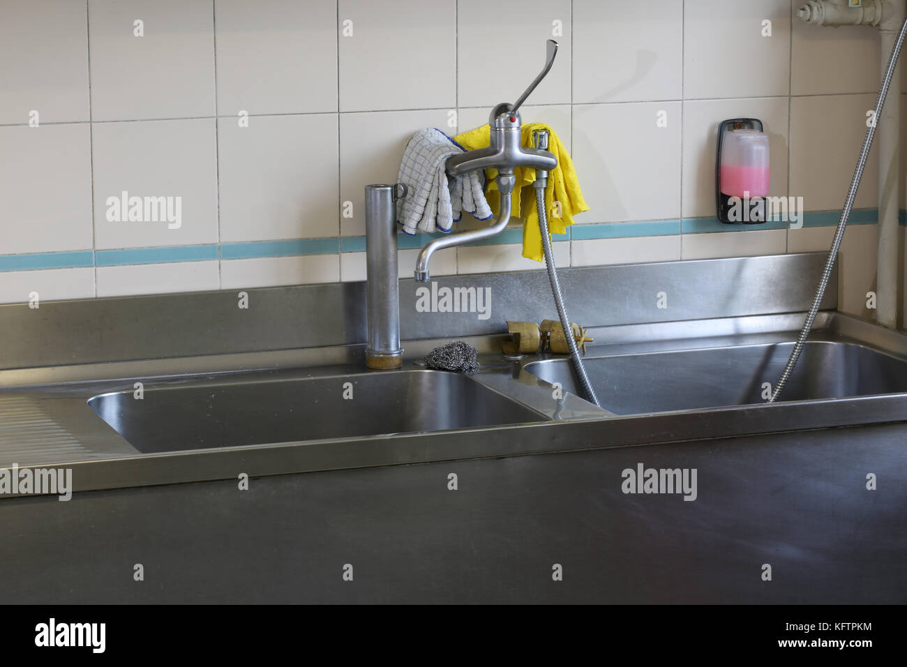 Interior Of An Industrial Kitchen With Stainless Steel Sink
