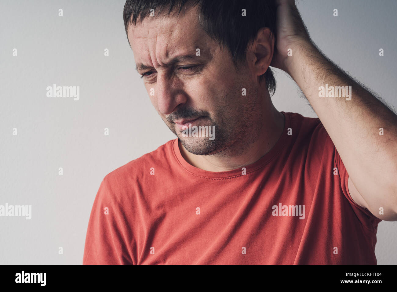 Forgetful absent-minded man is trying to remember something  that he managed to forget. - Stock Image