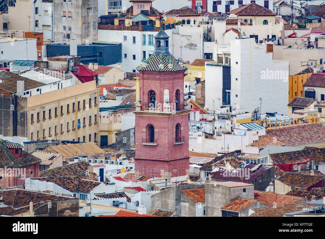 Church tower over houses - Stock Image