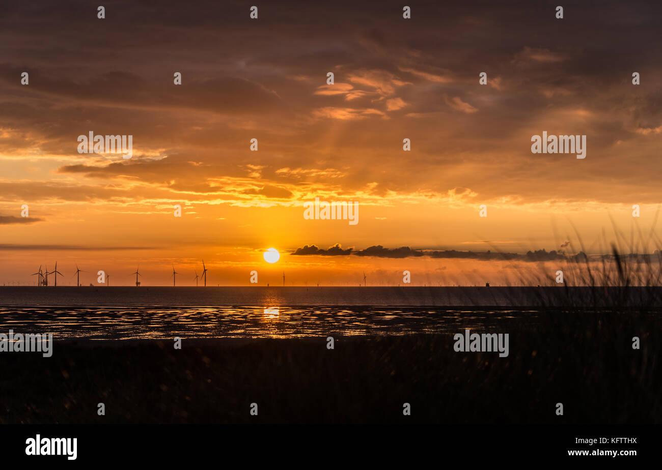 Wind turbines off shore from Formby Coast. North West England - Stock Image