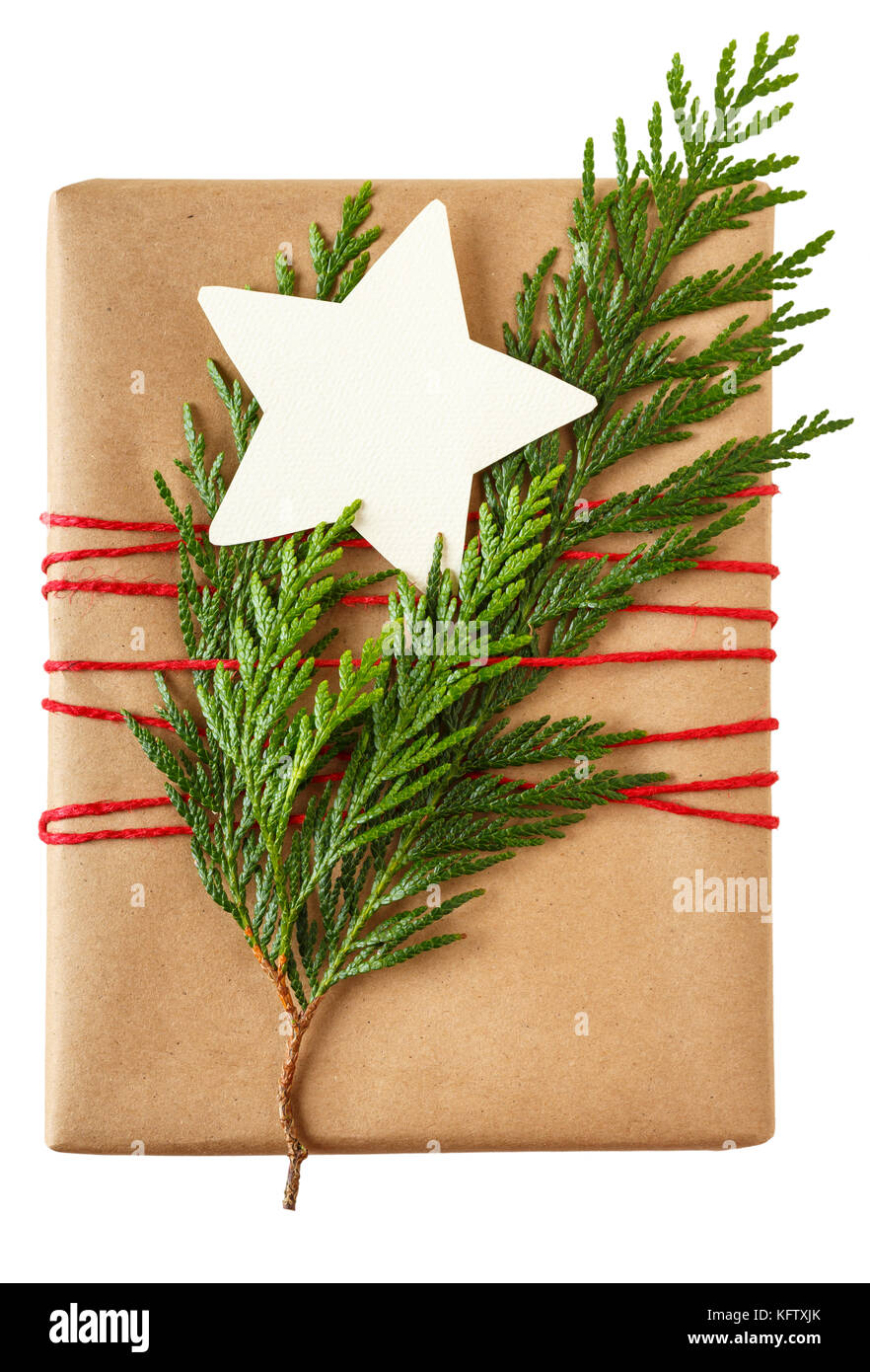 simple rustic christmas gift present with recycled wrapping paper