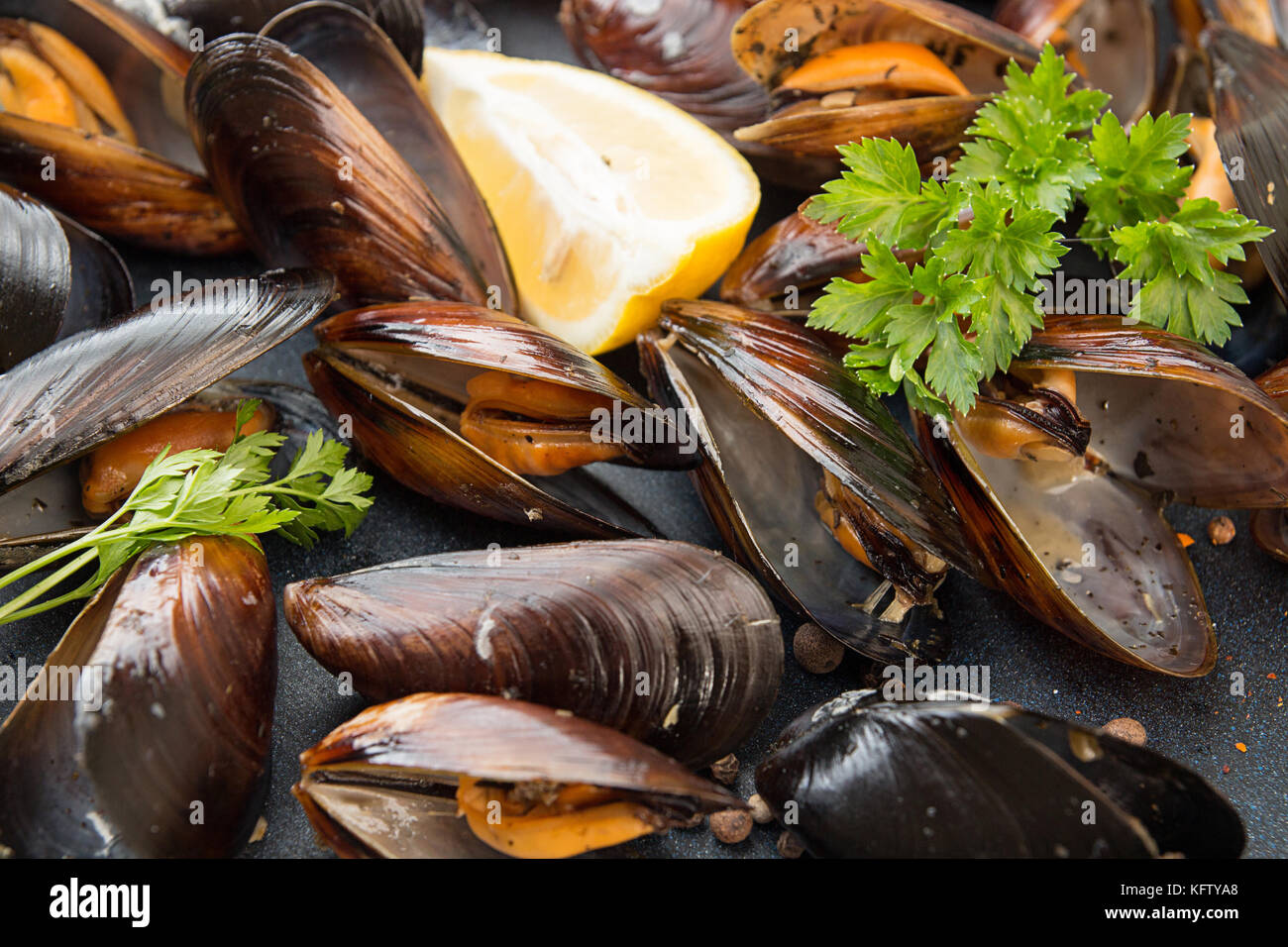 Grilled mussels in its shell. Close up. Healthy food dieting concept Stock Photo