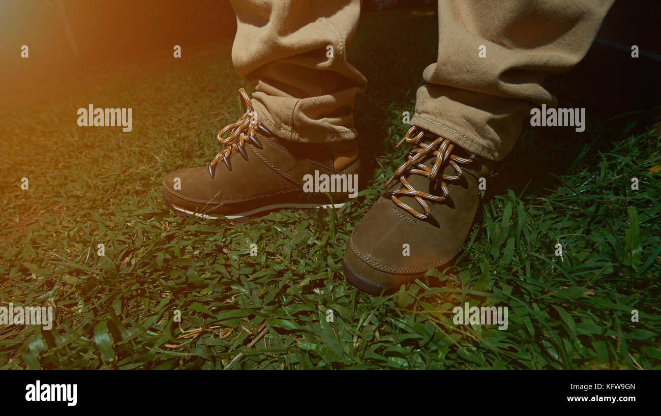 Man Stand In Hiking Boots On Green Grass Close Up Ready For