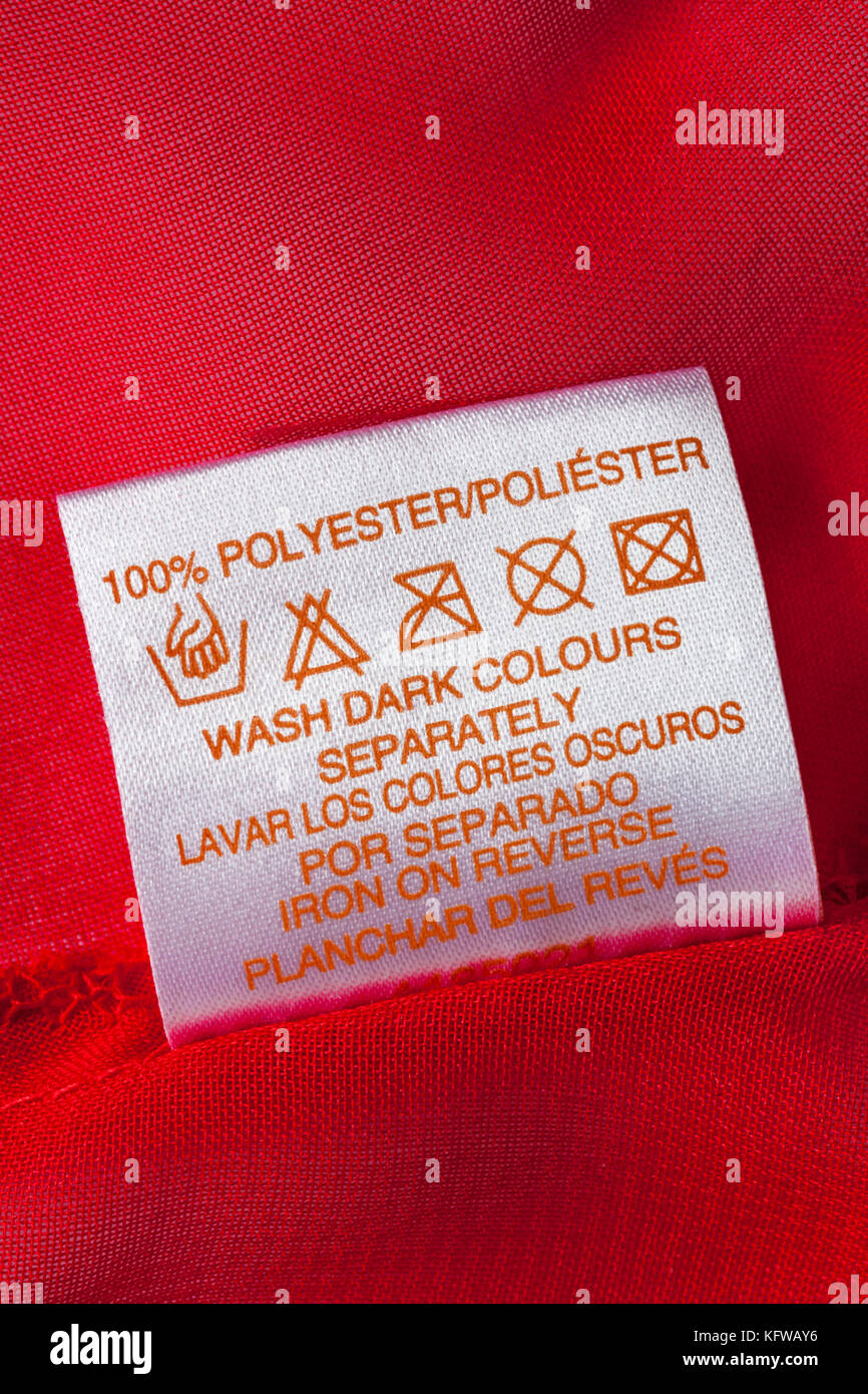 Washing symbols stock photos washing symbols stock images alamy 100 polyester label in womans red clothing with wash care symbols and instructions wash biocorpaavc Choice Image