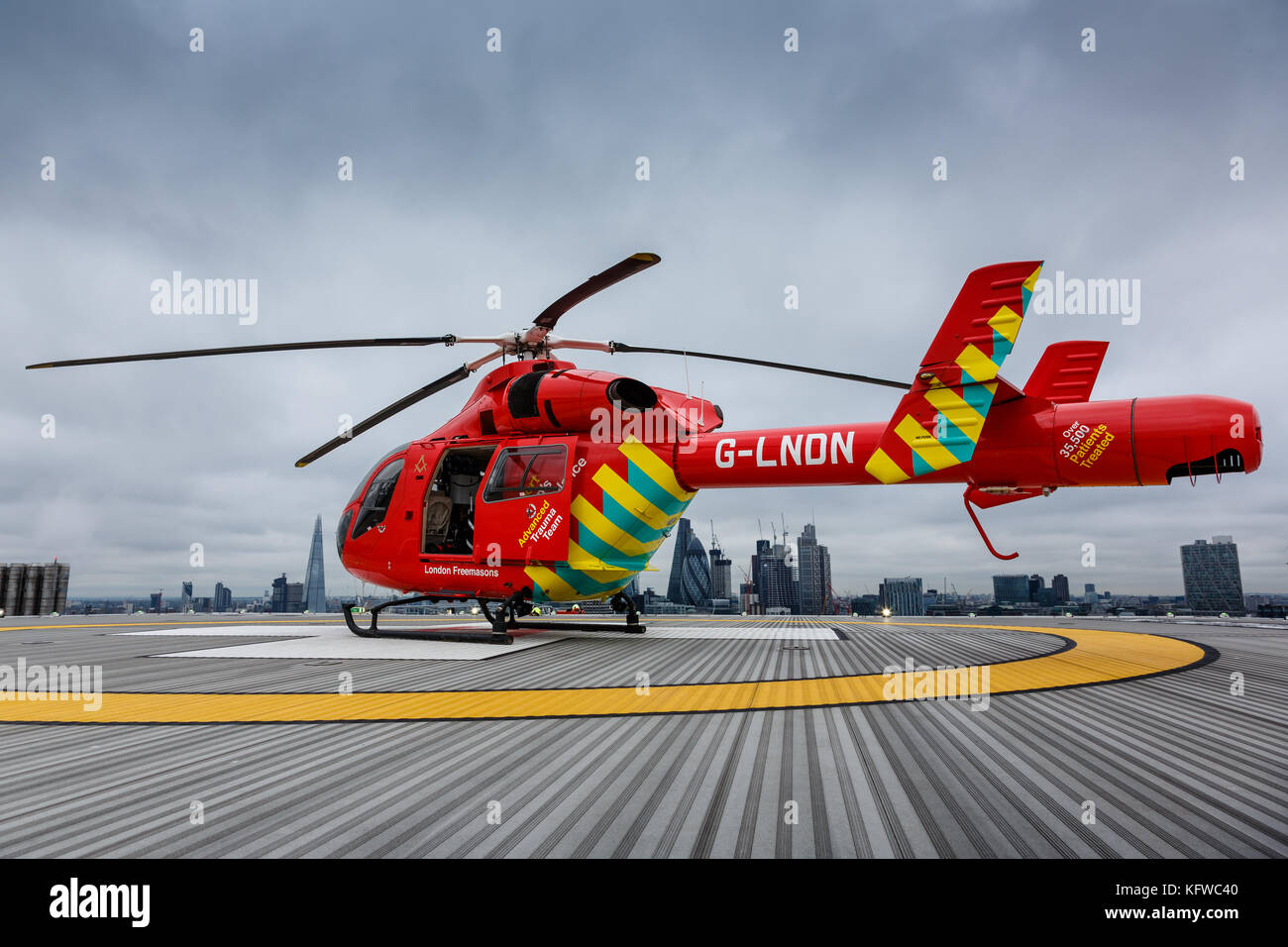 London Air Ambulance lands on the helipad of the Royal London Hospital - Stock Image