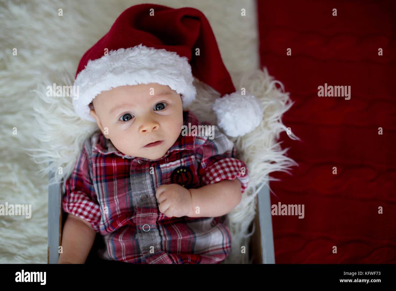 Christmas Portrait Of Cute Little Newborn Baby Boy Dressed In Stock