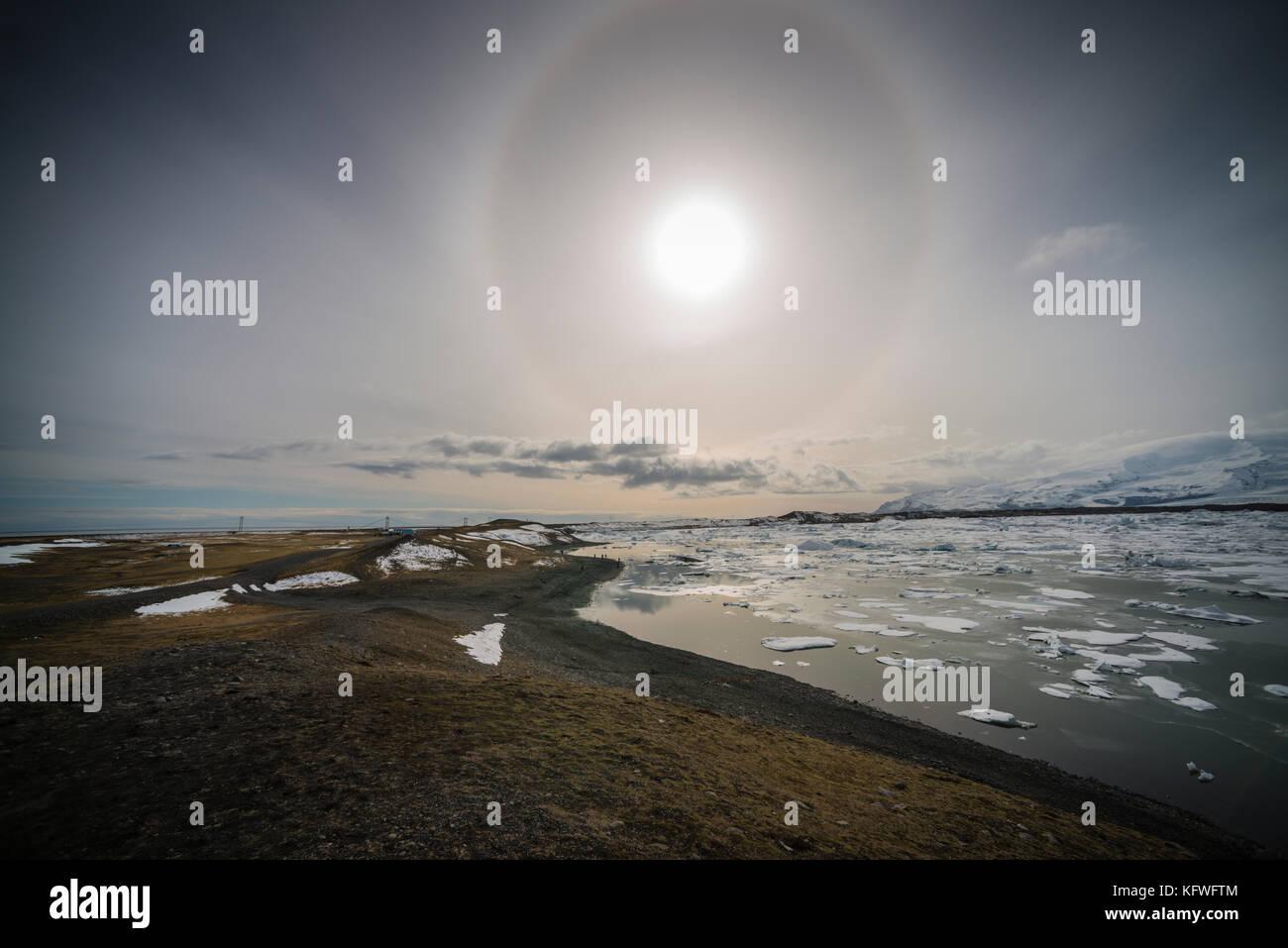 Sunbow over Jokulsarlon lagoon, Iceland. - Stock Image