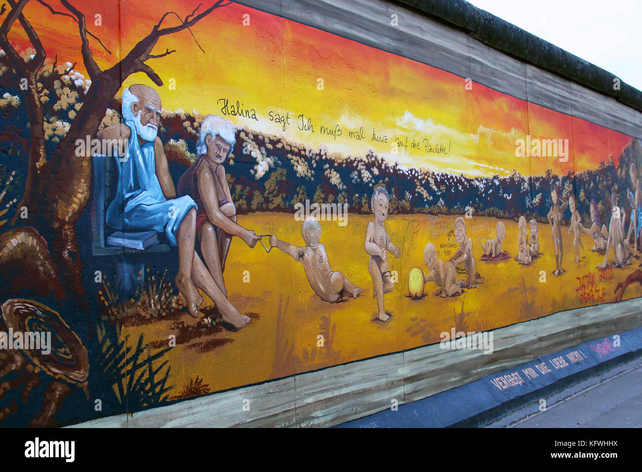 Fragment of the East Side Gallery exhibition, the largest outdoor art gallery in the world, painted on the segment - Stock Image