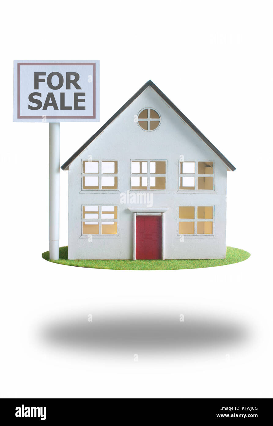 House for sale floating on grass platform - Stock Image