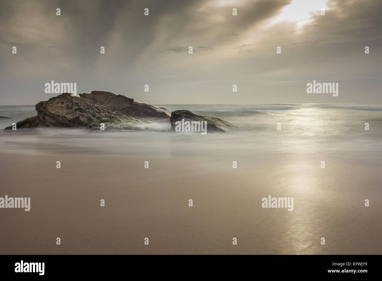 Guincho Beach, Portugal, Sunrise at low tide. - Stock Image