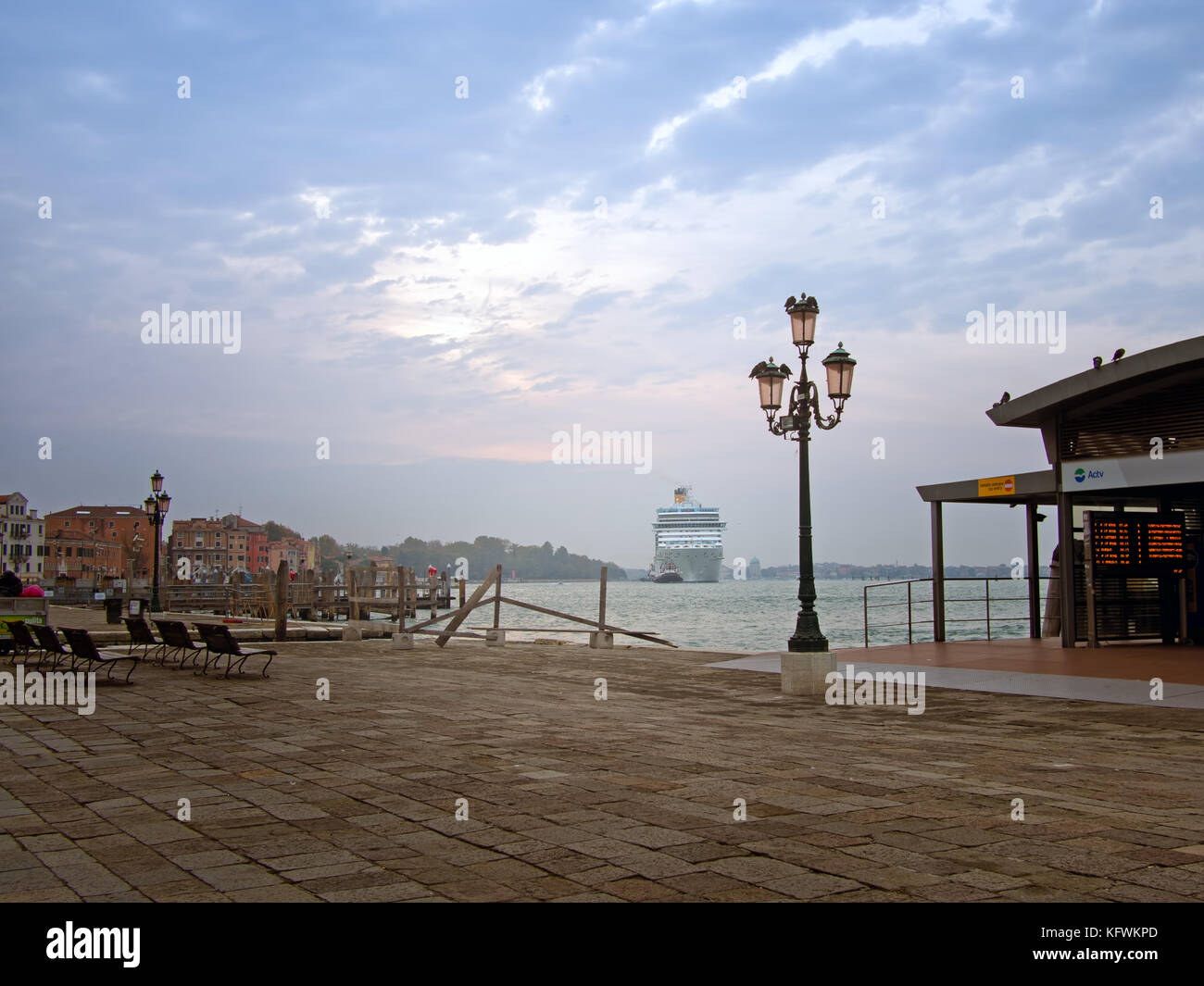 Cruise ship entering Venice. Early morning tourists arrival. - Stock Image