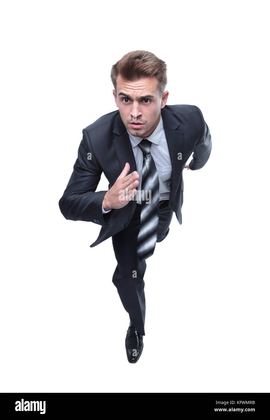 closeup face of a running businessman - Stock Image