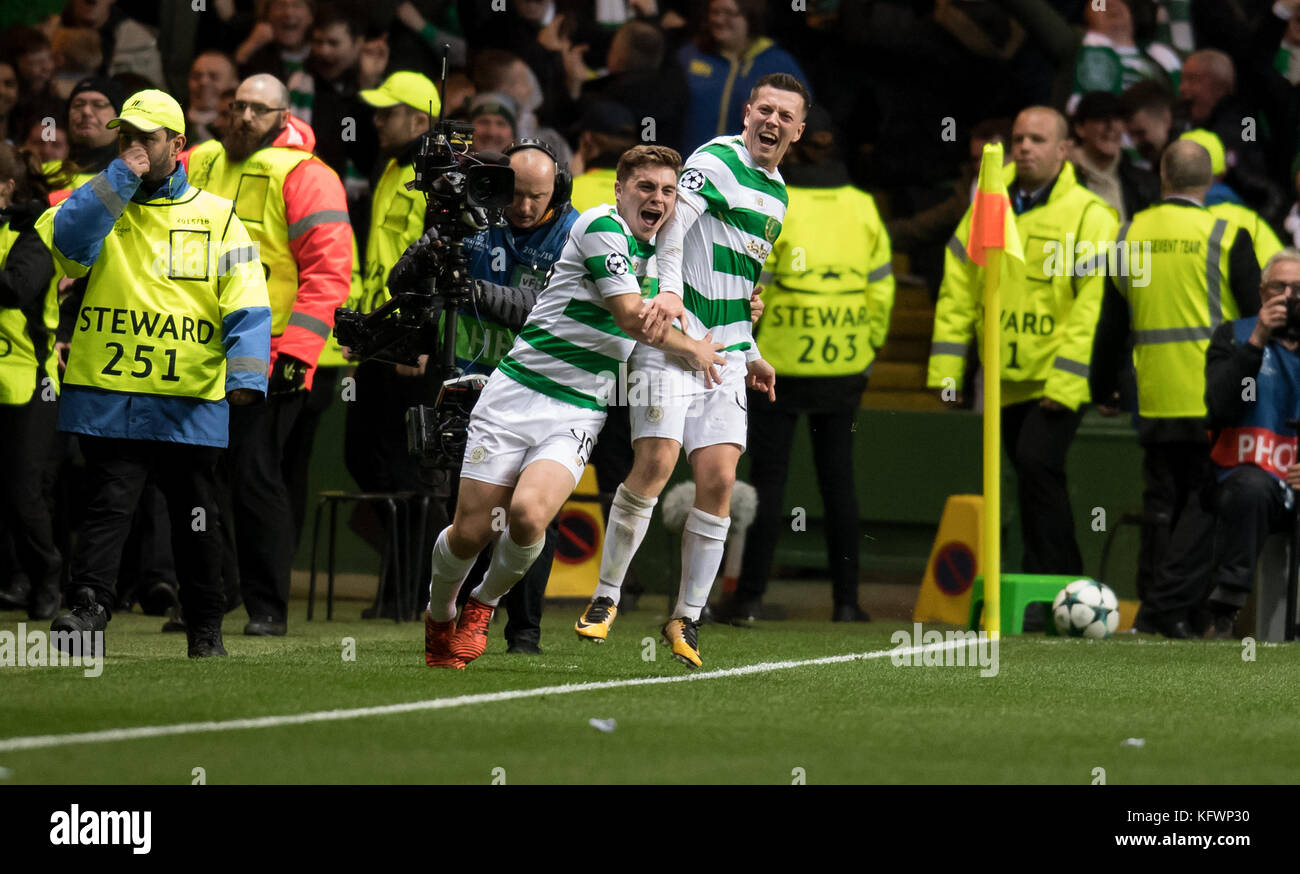 Callum McGregor (L) and James Forrest of Glasgow cheer over the 1-1 equalizing score during the Champions League - Stock Image